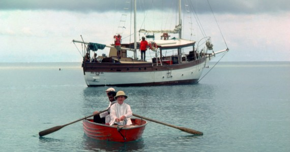 "Fr. Jack Fahey being rowed out to ""Star of the Sea"" on his return to the Western Islands in Chuuk (early 1970s)."
