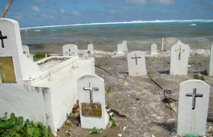 High tides flooding a graveyard in the downtown Majuro, Republic of the Marshall Islands