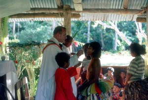 Fr. Horgan distributing communion in Yap.